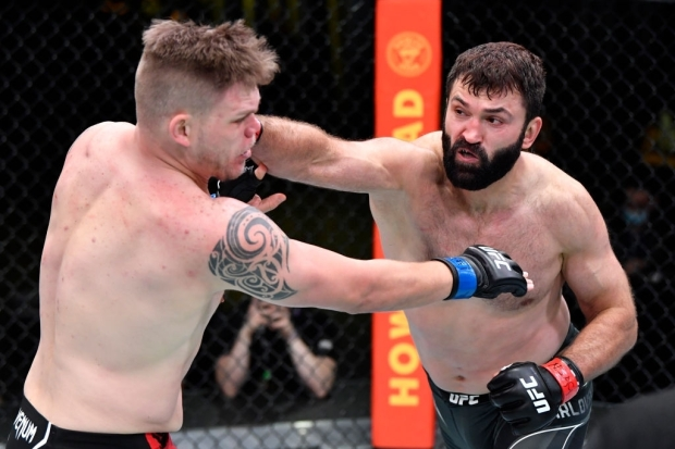 LAS VEGAS, NEVADA - APRIL 17: In this handout photo, (R-L) Andrei Arlovski of Belarus punches Chase Sherman in a heavyweight fight during the UFC Fight Night event at UFC APEX on April 17, 2021 in Las Vegas, Nevada. (Photo by Chris Unger/Zuffa LLC)