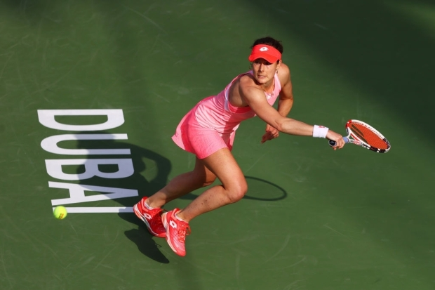 DUBAI, UNITED ARAB EMIRATES - MARCH 09: Alize Cornet of France stretches to play a backhand in her Round Two match against Aryna Sabalenka of Belarus during Day Three of the Dubai Duty Free Tennis Championships at Dubai Duty Free Tennis Stadium on March 09, 2021 in Dubai, United Arab Emirates. (Photo by Francois Nel/Getty Images)