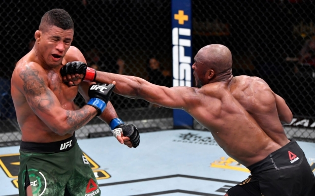 LAS VEGAS, NEVADA - FEBRUARY 13: (R-L) Kamaru Usman of Nigeria punches Gilbert Burns of Brazil in their UFC welterweight championship fight during the UFC 258 event at UFC APEX on February 13, 2021 in Las Vegas, Nevada. (Photo by Jeff Bottari/Zuffa LLC)