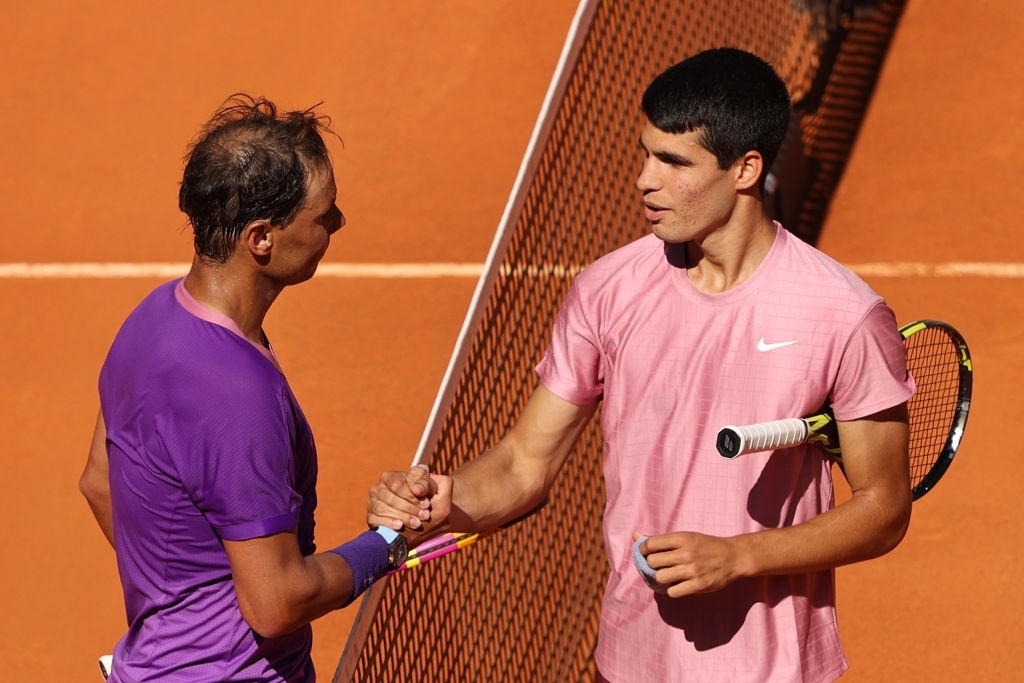 MADRID, SPAIN - MAY 05: Rafael Nadal of Spain shakes hands with Carlos Alcaraz of Spain after winning their second round match during day seven of the Mutua Madrid Open at La Caja Magicaon May 05, 2021 in Madrid, Spain. (Photo by Clive Brunskill/Getty Images)