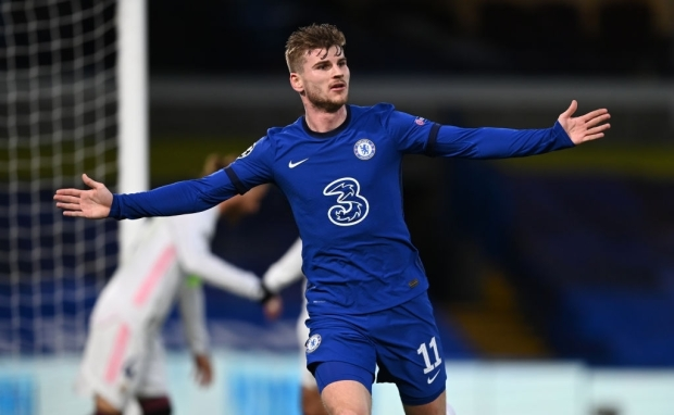 LONDON, ENGLAND - MAY 05: Timo Werner of Chelsea celebrates after scoring his team's first goal during the UEFA Champions League Semi Final Second Leg match between Chelsea and Real Madrid at Stamford Bridge on May 05, 2021 in London, England. Sporting stadiums around Europe remain under strict restrictions due to the Coronavirus Pandemic as Government social distancing laws prohibit fans inside venues resulting in games being played behind closed doors. (Photo by Darren Walsh/Chelsea FC via Getty Images)
